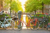 stock photo of bridges  - Bikes on the bridge in Amsterdam Netherlands - JPG