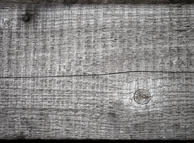 foto of uncolored  - Closeup texture of uncolored old knotted wooden lining board - JPG