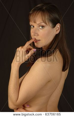 Brunette Woman With Finger On Lip