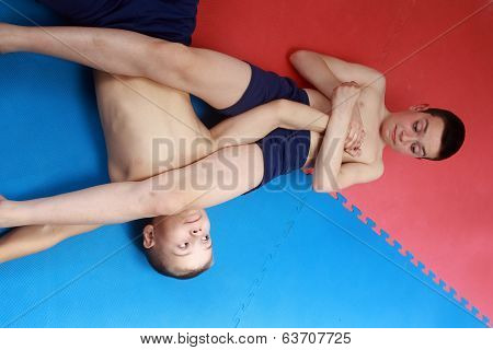 In shorts athletes perform retention hands on the mat