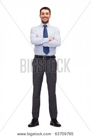 business and office concept - handsome buisnessman with crossed arms