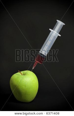 Spritze in grüner Apfel