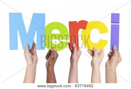 Group of Multiethnic Hands Holding Merci