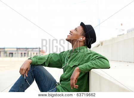 Man Listening To Mp 3 Player