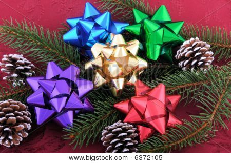 Christmas Bows Evergreen Branch And Pine Cones