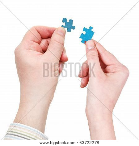 Male And Female Hands With Little Puzzle Pieces