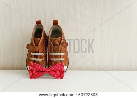 Bow Tie And Shoes On Background Wall With Wallpaper