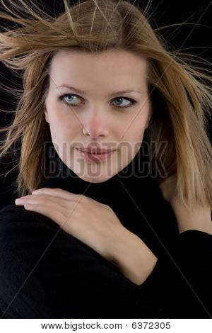 Blonde Girl In A Black Turtleneck