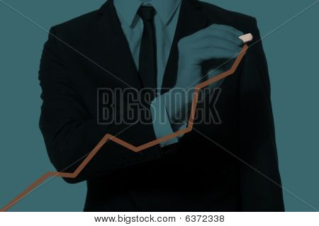 Hand Of A Businessman Drawing Diagram
