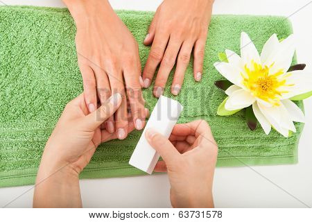 Beautician Polishing The Nails