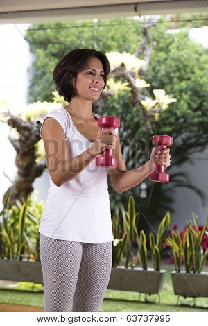 Attractive Woman Exercising With Dumbbells