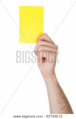 Hand Showing Yellow Card