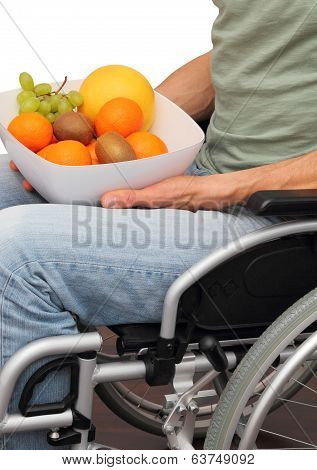 Wheelchair User With A Fruit Bowl