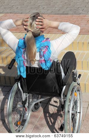 Wheelchair User In Front Of A Stair