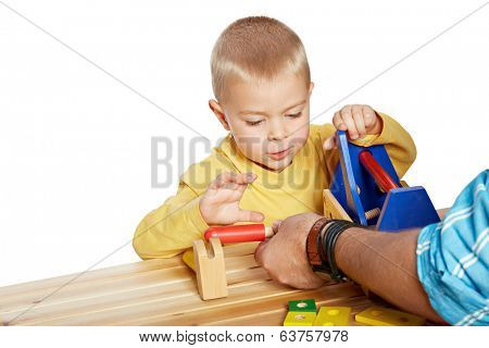 Little boy and his father playing with wooden eco friendly toys on isolated white background