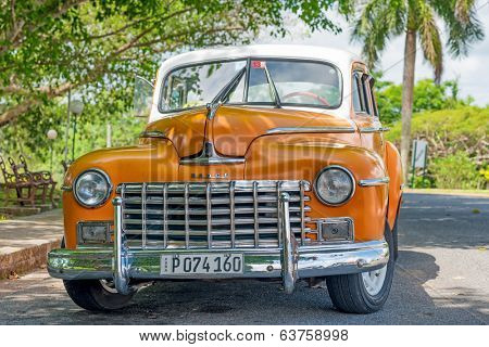 HAVANA,CUBA - APRIL 15, 2014: Beautifully restored old classic Dodge car in Havana. These antique cars are a common sight in Cuba and have become a worldwide known touristic attraction