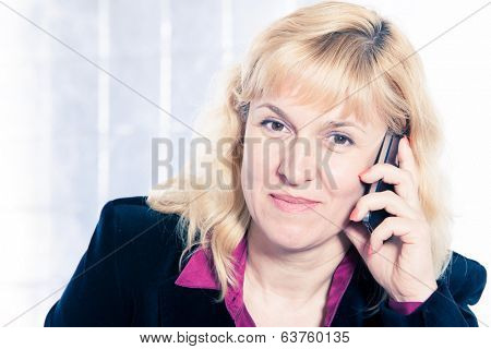Beautiful businesswoman portrait with mobile phone