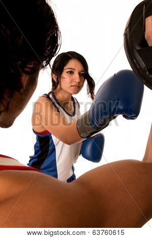 Female boxer training with male partner. Studio shot over white.
