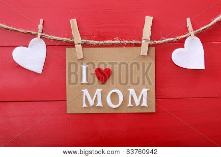 Mothers Day Message With Clothespins Over Red Wooden Board