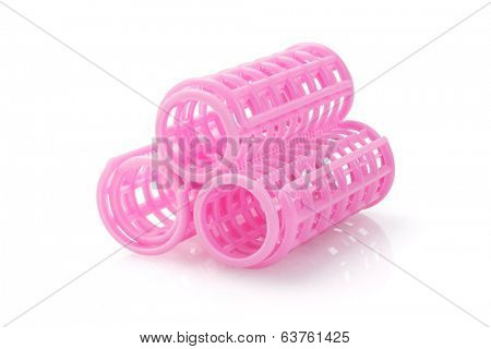 Three Plastic Hair Curlers On White Background