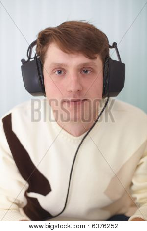 Portrait Of Person In Big Stereos Ear-phones