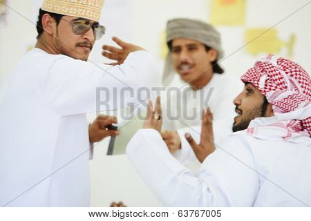 Gulf Arabic Muslim people posing