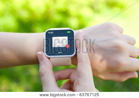 Isolated Female Hands With White Smartwatch With Email On The Screen