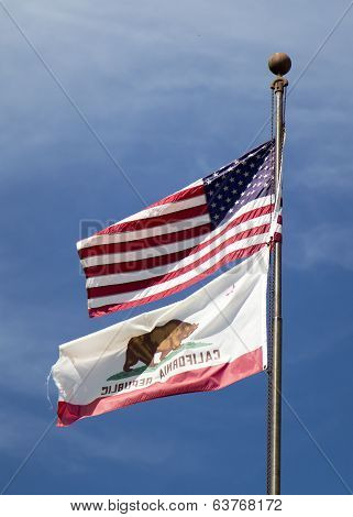 American flag and flag of California