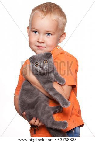 Child with lop-eared cat isolated on white