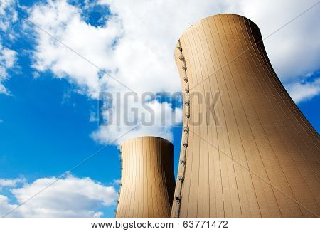 Nuclear Power Plant Against Blue Sky And Clouds