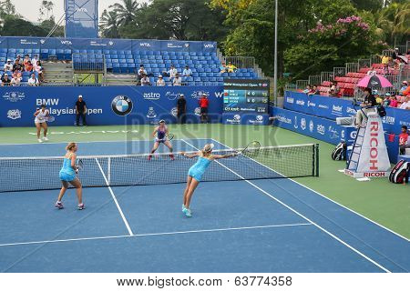 KUALA LUMPUR - APRIL 19, 2014: Chan Yung-Jan and Zheng Saisai take on Olga Savchuk and Lyudmyla Kichenok in the women's semifinals of the BMW Malaysian Open tennis is Kuala Lumpur, Malaysia.
