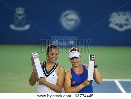 KUALA LUMPUR - APRIL 20, 2014:Chan Hao-Ching (white) of Taiwan and Timea Babos of Hungary emerge champions in the Doubles of the BMW Malaysian Open Tennis in Kuala Lumpur, Malaysia.