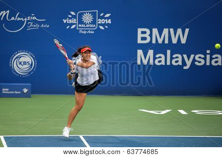 KUALA LUMPUR - APRIL 20, 2014: Chan Yung-Jan of Taiwan returns at the doubles final of the BMW Malaysian Open Tennis in Kuala Lumpur, Malaysia. She partners Zheng Saisai of China to emerge runners-up.
