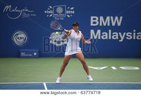 KUALA LUMPUR - APRIL 19, 2014: Chan YungJan returns in the semifinals of the BMW Malaysian Open tennis in Kuala Lumpur, Malaysia. Partnering Zheng Saisai, they beat Olga Savchuk and Lyudmyla Kichenok.