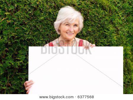 Senior Woman Holding Board