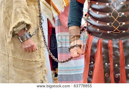 roman soldier and  handcuff prisoner