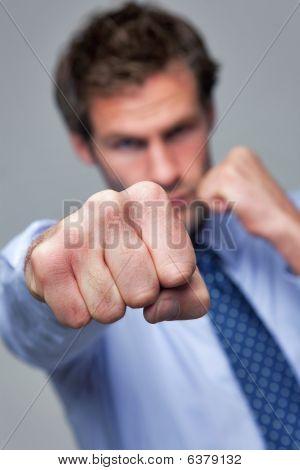 Businessman Punching Towards Camera