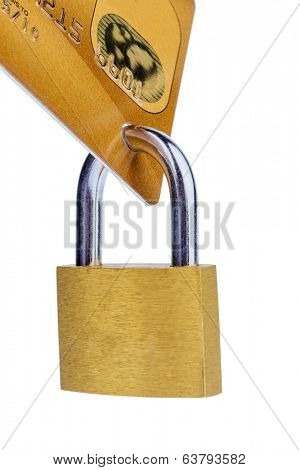 a golden credit card and padlock. symbolic photo for cashless purchases and status symbols.