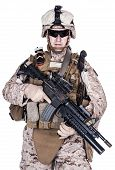 stock photo of assault-rifle  - US marine with his assault rifle on white background - JPG