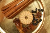 picture of ouzo  - Cookies spices and coffee beans on golden plate - JPG