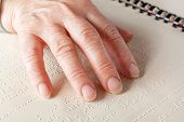 pic of braille  - Blind old woman reading text in braille language - JPG