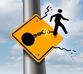 image of runaway  - Escaping to freedom business concept as a businessman symbol on a traffic sign breaking free from the restrains of a ball and chain as a success metaphor of a new career or conquering adversity and emotional stress - JPG