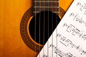 foto of musical scale  - A classical guitar and a music sheet - JPG
