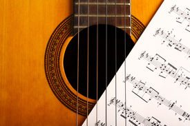 image of musical scale  - A classical guitar and a music sheet - JPG