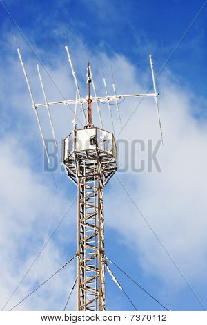 Radio Antenna Communication Tower At Winter Snow