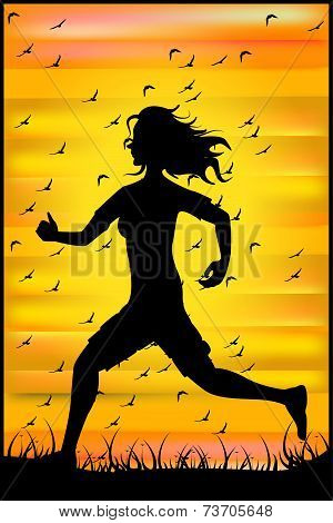 Silhouette Of A Running Athlete At Sunset And A Flock Of Birds