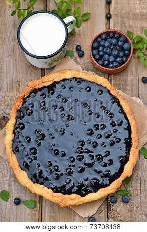 Blueberry Pie, Cup Of Milk On Wooden Table