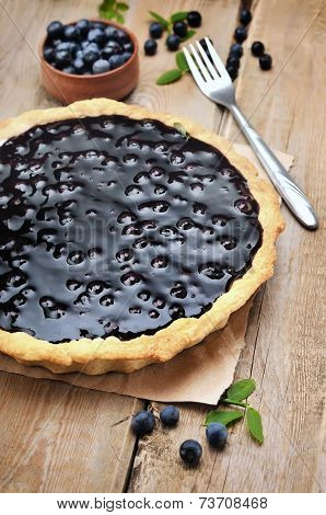 Blueberry Pie And Fresh Berries On Wooden Table