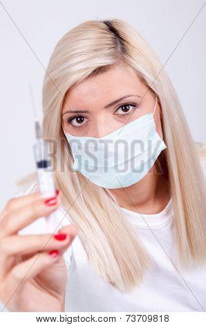 Female Doctor Or Nurse In Medical Mask Holding Syringe With Injection