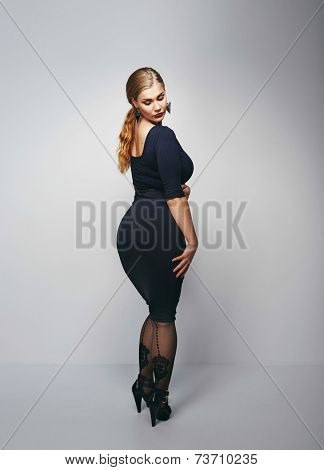 Voluptuous Woman Posing In Black Dress